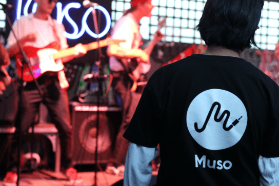 Muso staff member wearing a branded tshirt at a live gig.
